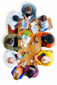 overhead view of team members sitting at table during a meeting