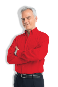 man in red dress shirt standing with arms crossed
