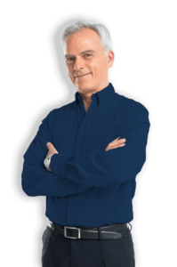 man in blue dress shirt standing with arms crossed