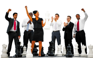 business professionals standing on life-size chess board