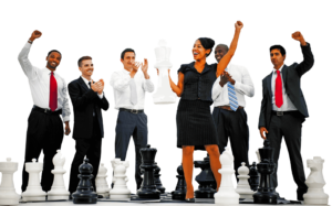 business professionals standing among large chess pieces